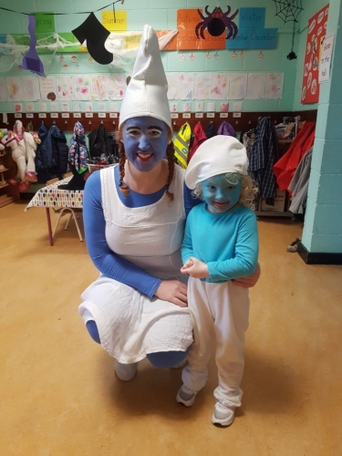 Our  wonderful Hallowen organiser Ms.Tiernan with a junior smurf!